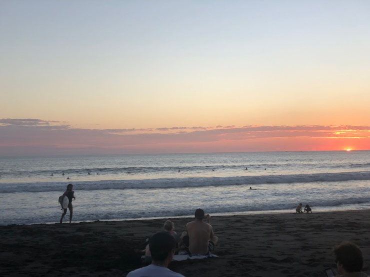 surf competition sunset